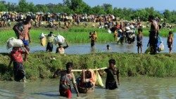 Rohingya refugees fleeing violence in Myanmar to reach Palongkhali in Bangladesh in Oct, 2017.