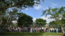 Colombian voters queue at a polling station