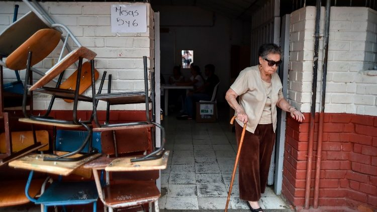 An elderly woman at a polling station in Calì during Presidential elections in Colombia