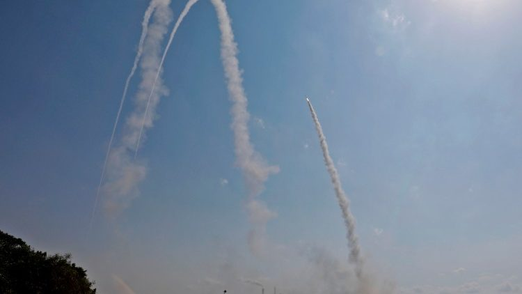 Israel's military launch missiles at positions in the Gaza Strip