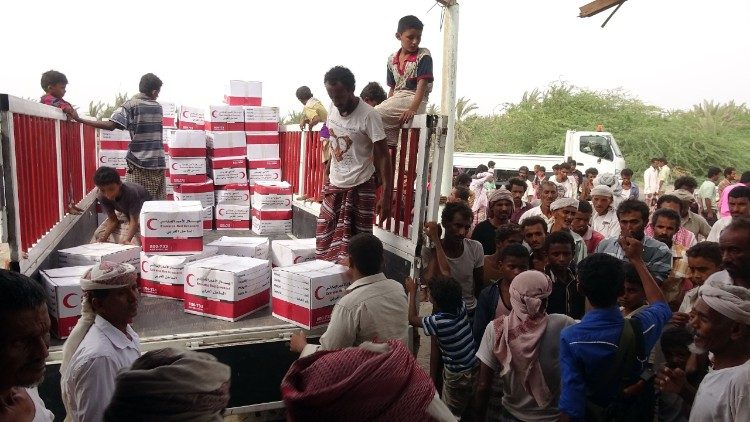 Humanitarian aid being unloaded at a coastal town near Hodeida in Yemen
