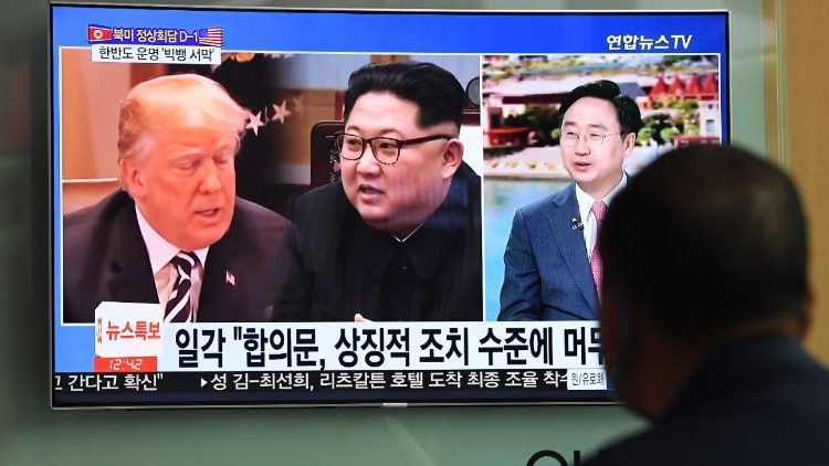 A man follows progress of the North Korea-US summit