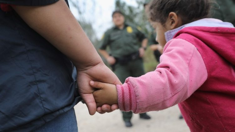 Immigrants meeting border patrol at the US - Mexico border