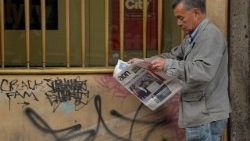 a man reads a local newspaper in Bogota after conservative Ivan Duque won Colombia's runoff election