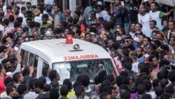 Ethiopians gather round an ambulance after an explosion in Addis Ababa