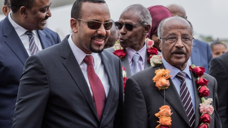 Eritrean Foreign Minister, Osman Saleh Mohammed (R) with Ethiopia's Prime Minister Abiy Ahmed at the ariport in Addis