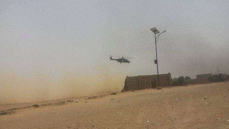 An army helicopter carries out surveillance in Mali