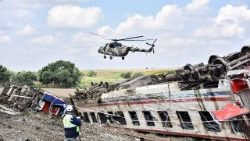 A helicopter flies over the site of a deadly train crash in Turkey