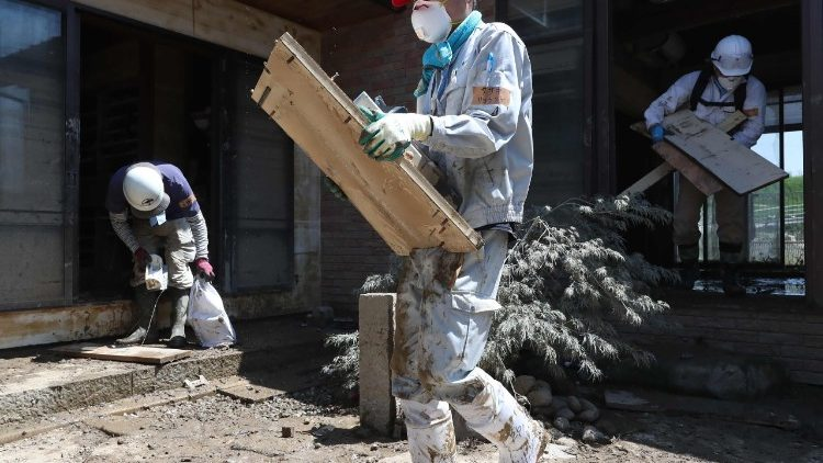Volunteers cleaning a home in Kurashiki, following the recent floods that hit south-west Japan.