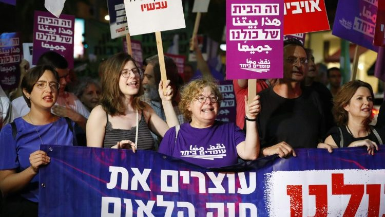 "Demonstrators attend a rally to protest against ""Jewish Nation-State Bill"", Tel-Aviv"