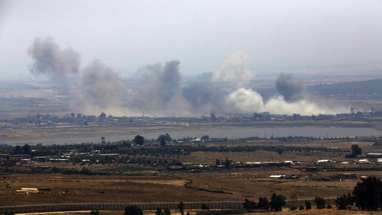 Smoke rises from buildings from air stricks on the border between Syria and Israeli-occupied Golan Heights.