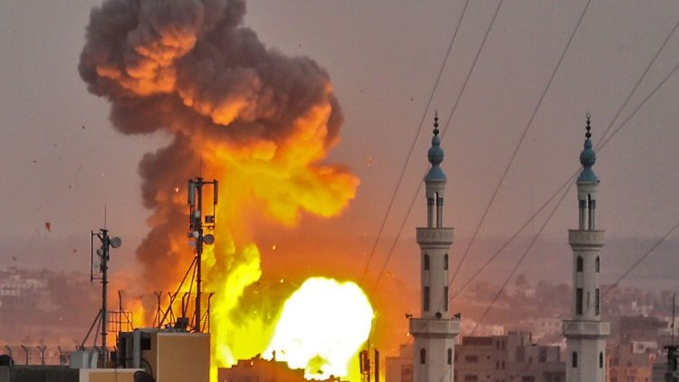 A fireball explodes in Gaza City during an Israeli bombardment on 20 July