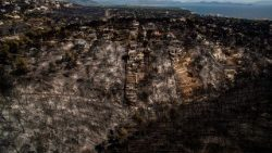 An aerial view shows extensive fire damage in the village of Mati near Athens
