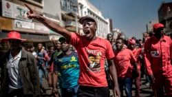Supporters of the opposition party MDC protest against alleged fraud by the election authority and ruling party