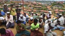 Rohingya refugees pray on the one year anniversary of the military crackcown that caused them to flee to Bangladesh