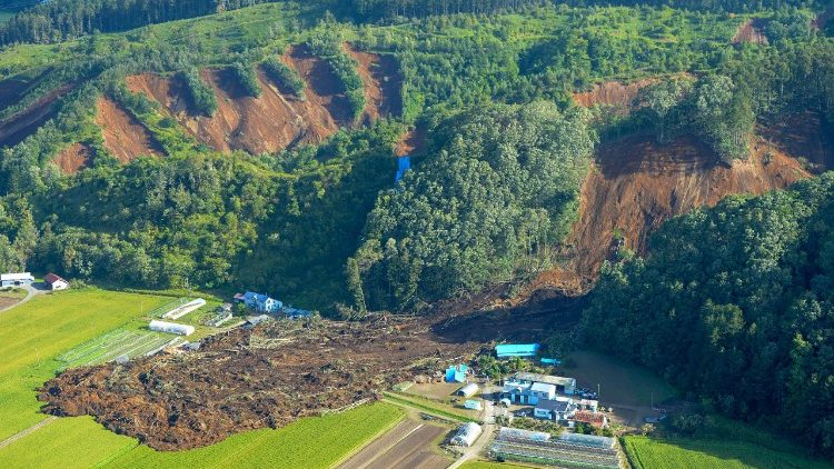Aerial view of houses damaged by a landslide in Atsuma town, Hokkaido