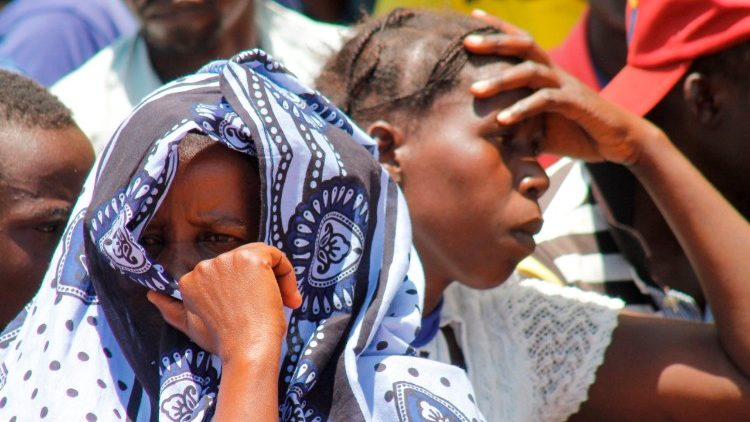Relatives attend the burial service of victims of the MV Nyerere on the shores of Ukara Island, Tanzania