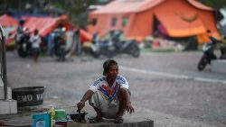A survivor of Indonesia's earthquake and tsunami at a makeshift camp in Palu.
