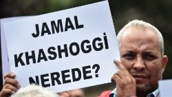 "A man holds a placard reading ""Where is Jamal Kashoggi?"", October 9th"