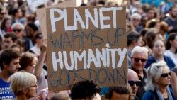 Demonstators take to the streets  in Paris calling for action against climate change