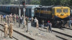Indian police stand guard as a freight train nears Amritsar railway station