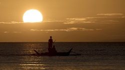 fishing by Boracay island Philippines as the sun sets