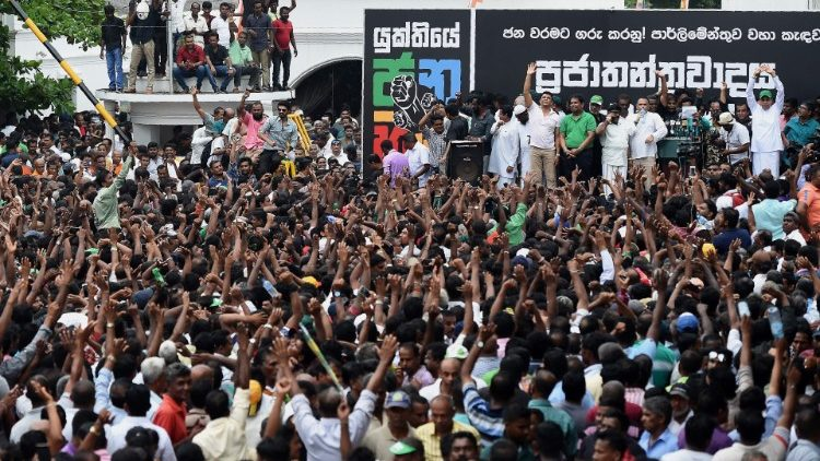 Supporters of ousted Sri Lanka's Prime Minister Ranil Wickremesinghe protesting his sacking by the president.