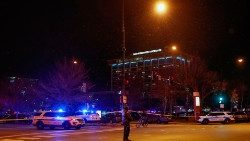 Chicago police officers stand outside the Mercy Hospital