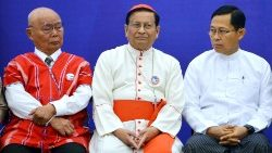 Cardinal Charles Bo flanked by two Myanmar leaders at a peace meeting in November 2018.