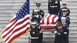 Body of George HW Bush leaves the US Capitol during a state funeral in Washington DC.