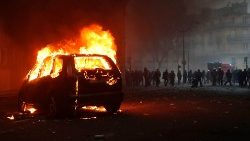 Car burns during a protest of yellow vests in Paris