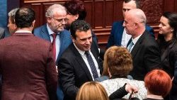 Macedonia's Prime Minister greets deputies after their vote to change the country's name to The Republic of North Macedonia