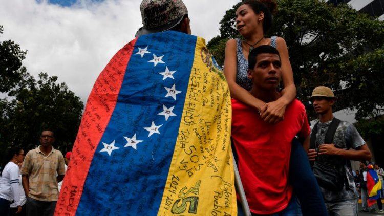 Opposition demonstrators take part in protests against the government of Nicolas Maduro