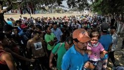 Venezuelan migrants gather at a shelter on the border with Colombia where the Catholic Church and the UN provide meals for more than 4000 people every day