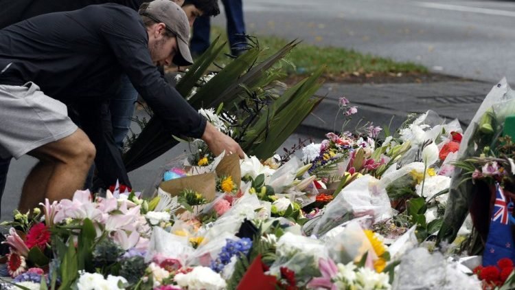 People lay flowers following New Zealand attacks