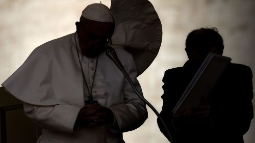 Pope Francis pauses to pray at the weekly General Audience