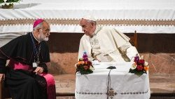 Pope Francis speaks with the Archbishop of Rabat