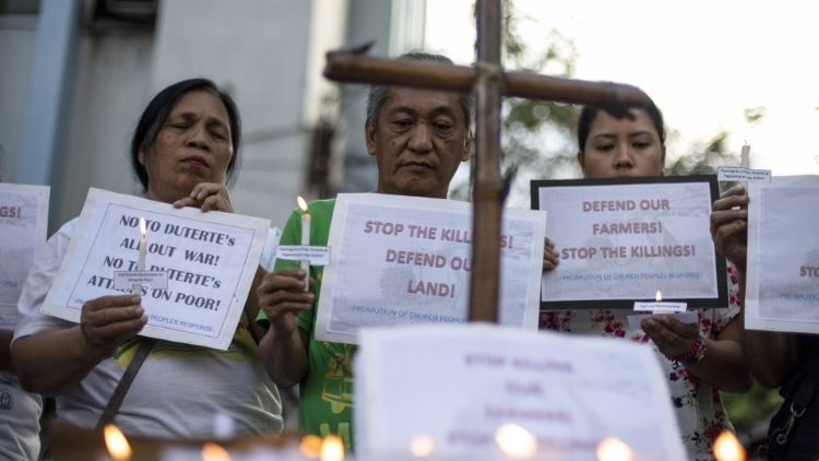 Filipinos protesting the killing of 14 farmers in a crossfire between security forces and suspected communist rebels.
