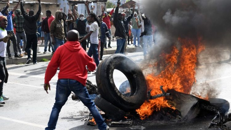 South Africans protest poor service delivery. Protests led to xenophobic violence.