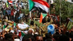 Sudanese demonstrators gather in central Khartoum immediately after the ousting of President Omar al-Bashir