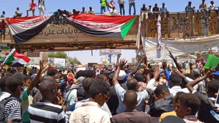 Sudanese demonstrators gather near the military headquarters in Khartoum