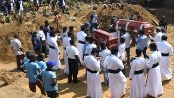 Mourners burying their loved ones in a cemetery  in Negombo, Sri Lanka.