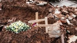 Flowers and crosses placed on the debris after the house of a school carer was destroyed by a mudslide killing 8 people south of Durban in South Africa