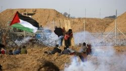 Palestinian protesters clashing with Israeli forces near the border in southern Gaza strip.