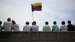 Oppositioin demonstrators take part in a May Day rally in Caracas
