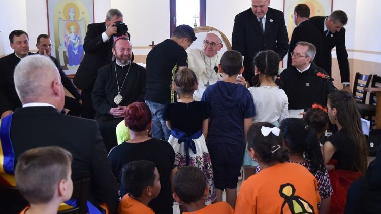 Pope Francis meets with members of the Roma community in the Barbu Lautaru district of Blaj