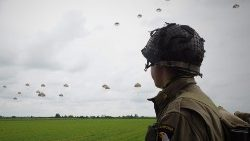 Paratroopers perform a jumb over Sannerville in north-western France prior to D-Day commemorations
