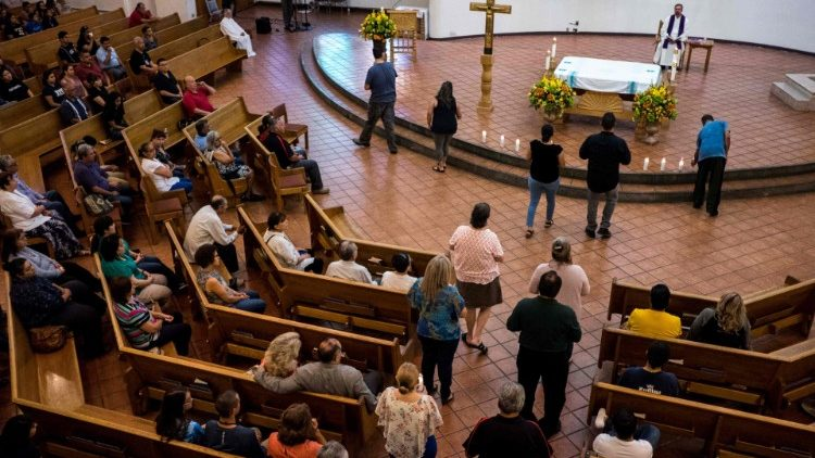 Mourners take part in a Vigil at the St Pius X Catholic Church in El Paso