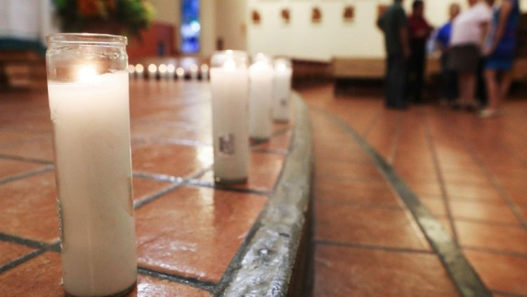 Candles are lit at a Vigil at Pius X Church after a mass shooting in El Paso, Texas
