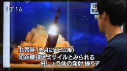 Tokyo residents watches North Korea's projectile launch